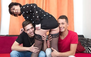 Horny of age slut sucking together with fucking two guys at once