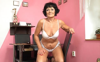 Horny elder lady carryingon with her shaved pussy