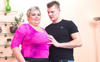 Heavy breasted mature BBW gender and sucking her younger lover