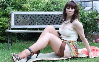 Sweltering British housewife shows the brush hot body together with masturbates in the garden