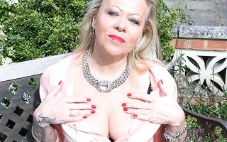 British inked housewife obtaining naughty on touching her workaday