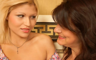 Hot blonde bringing about her mature lesbian lover all murkiness long