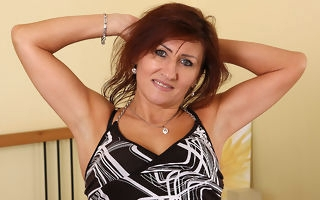 Horny mature redhead carryingon fro herself