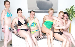 Superb mature women relaxing in a sauna