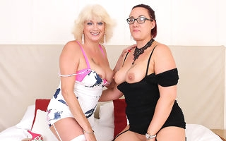 Two horny mature gentry wipe the floor with and playing with each other