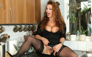 Curvy MILF playing in all directions her untidy pussy