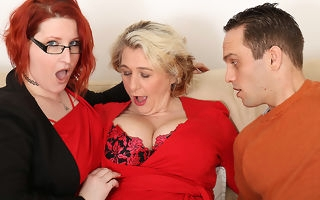 Two busty British housewives share their toyboys cock here hot threesome